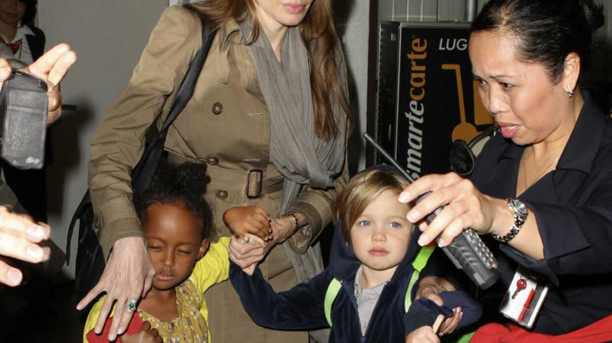 PHOTOS Angelina jolie protégée par sa fille Shiloh