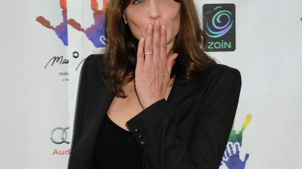 PHOTOS Carla Bruni entou­rée de people pour le Mandela day