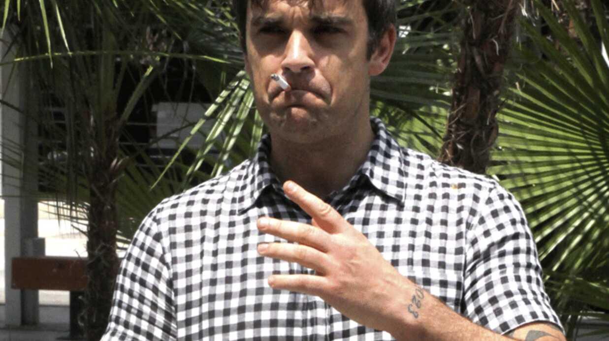 Robbie Williams: interrogé par la police dans le cadre d'un braquage violent