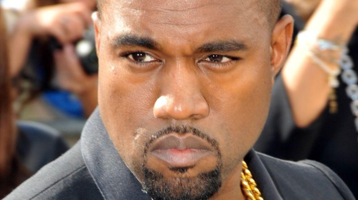 Kanye West fait un gros câlin à un paparazzi